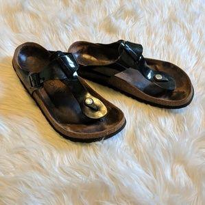 Birk Betula patent leather T strap sandals